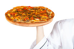Hot pizza in hand Royalty Free Stock Photos