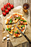 Hot pizza served with a cold drink Stock Photography
