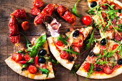 Hot pizza slice with meat and cheese on wooden table close up. Hot pizza slice with meat and cheese on wooden table close stock photography