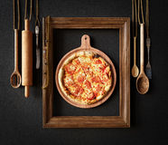 Hot pizza slice with melting cheese with frame concept close up photo. Background stock photos