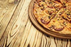 Hot pizza slice with melting cheese on a rustic wooden table.pepperoni pizza,Hot Homemade Pepperoni Pizza Ready to Eat,Supreme Pi stock photography