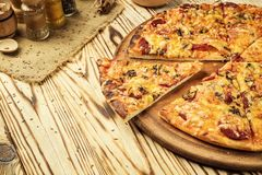 Hot pizza slice with melting cheese on a rustic wooden table.pepperoni pizza,Hot Homemade Pepperoni Pizza Ready to Eat,Supreme Pi stock image