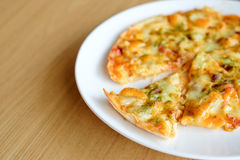 Hot pizza slice with melting cheese Stock Photography