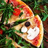 Hot pizza slice with Pepperoni, melting cheese on a rustic wooden table close up. Top view. Hot pizza slice with Pepperoni, melting cheese on a rustic wooden royalty free stock photos