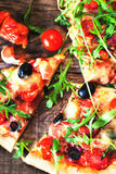 Hot pizza slice with Pepperoni, melting cheese on a rustic wooden table close up.. Hot pizza slice with Pepperoni, melting cheese on a rustic wooden table close royalty free stock photos