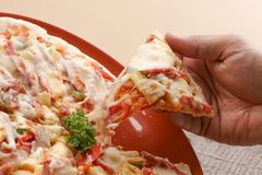 Hot pizza slice on wooden table. Pizza delicious for lunch royalty free stock images