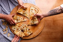 A hot pizza is taken away royalty free stock image