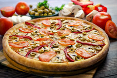 Hot pizza with vegetables. And mushrooms Stock Images