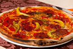 Hot pizza vith chili and salami served on a plate in italian res Royalty Free Stock Photo