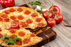 Hot pizza. On wooden background Stock Photos