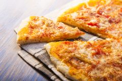 Hot Pizza on wooden table. The hot Pizza  on wooden table Royalty Free Stock Photos