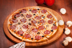 Hot Pizza. On the wooden table Stock Photos