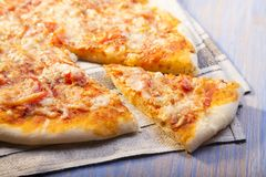 Hot Pizza on wooden table. The hot Pizza on wooden table Stock Image