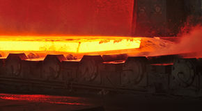 Hot plate on conveyor Royalty Free Stock Image