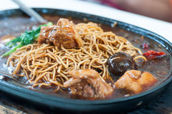 Hot plate mee with chicken Stock Photo