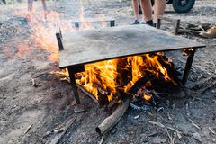 Hot plate warming up over a camp fire ready for cooking royalty free stock photos