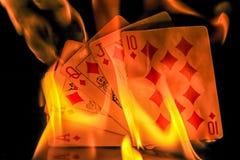 Hot Poker Hand. Royal straight flush of diamonds on fire Stock Photos