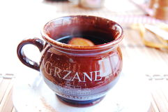 Hot Polish wine. With cinnamon served in a brown mug Royalty Free Stock Image