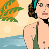Hot pop art girl on a beach Royalty Free Stock Photography