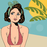 Hot pop art girl on a beach Stock Images