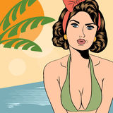 Hot pop art girl on a beach Royalty Free Stock Photo