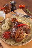 Pork knuckle with side dish and gravy stock image