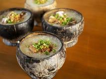 Hot porridge in a coconut shell bowl stock photo