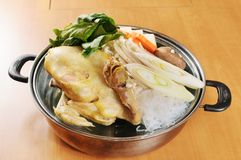 Hot pot. A wealth of chicken hot pot cooking stock photography