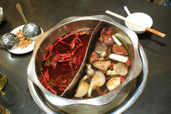 Hot pot. The hot pot the image shows originates in Sichuan China, it is extremely popular in China now, its characteristic is very spicy,but you can't resist its Royalty Free Stock Photos