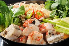Hot pot. A wealth of seafood hot pot cooking royalty free stock images