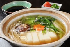 Hot pot. Chinese hot pot on the table stock photography