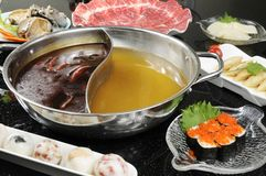 Hot pot. Chinese hot pot on the table Stock Photo