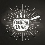 Hot pot chalk silhoutte with sun rays and lettering - Cooking time - on blackboard. Royalty Free Stock Image