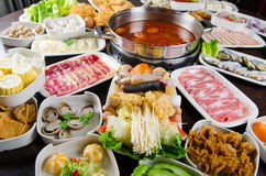 Hot pot feast. Spicy hot pot soup served with wide variety of ingredients Stock Images