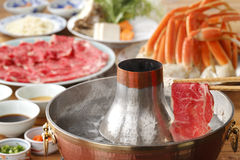 Hot pot of fresh beef and crab in Thai style Royalty Free Stock Photography