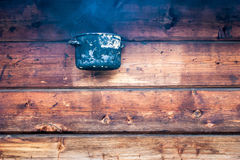 Hot pot. Over wooden wall Stock Image