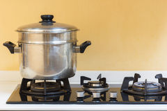 Hot pot set on gas stove in modern kitchen. Big hot pot set on gas stove in modern kitchen Royalty Free Stock Photo