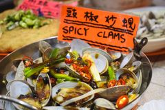 Hot pot with spicy clams sold on a street market in Hong Kong China stock images