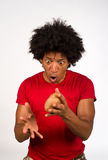 Hot potato. Guy juggling with a hot potato, not sure what to do with it Royalty Free Stock Photo