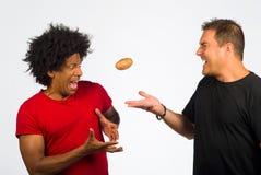 Hot potato. Passing on the hot potato, a concept stock photo