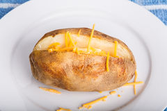 Hot Potato with Butter and Cheese Stock Photo
