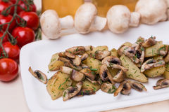 Hot potato and mushroom with garnish on white plate Stock Photography