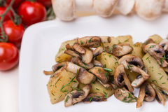 Hot potato and mushroom with garnish on white plate Stock Images