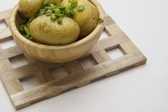 Hot potato on wooden grill copy space in right Stock Photos