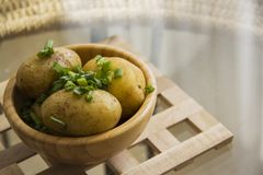 Hot potato on wooden grill Stock Photography