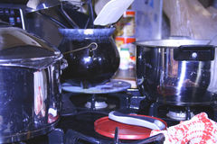 Hot pots on the stove. In the kitchen Stock Photo