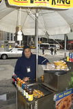 A pretzel salesman at work with his cart New York City Royalty Free Stock Photo