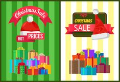 Hot Prices Xmas Sale Poster Santa Claus Hat Label. Hot prices Xmas sale poster Santa Claus hat on discount label, mountains of gift boxes on striped green yellow Stock Photos