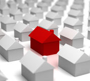 Hot Property amongst others. 3D render of a Red house amongst other grey ones Royalty Free Stock Photos