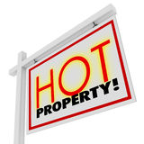 Hot Property Home House for Sale Real Estate Building Sign. Hot Property words in sizzling red letters on a white home or house for sale real estate sign to Stock Photo